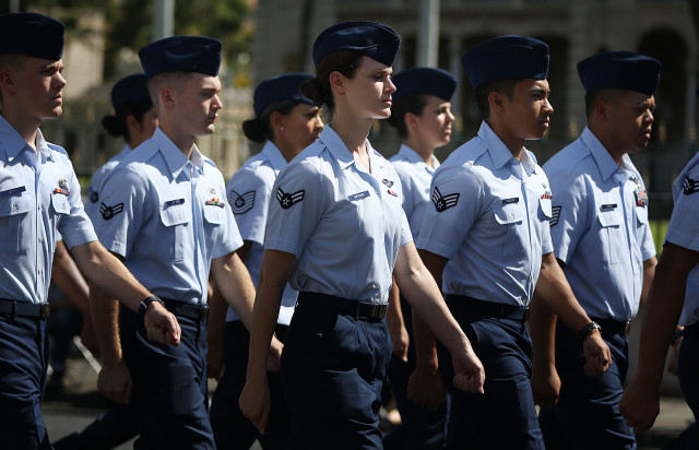 United States Air Force personnel march in the annual Kamehameha floral parade. 13 june 2015. photograph Cory Lum/Civil Beat