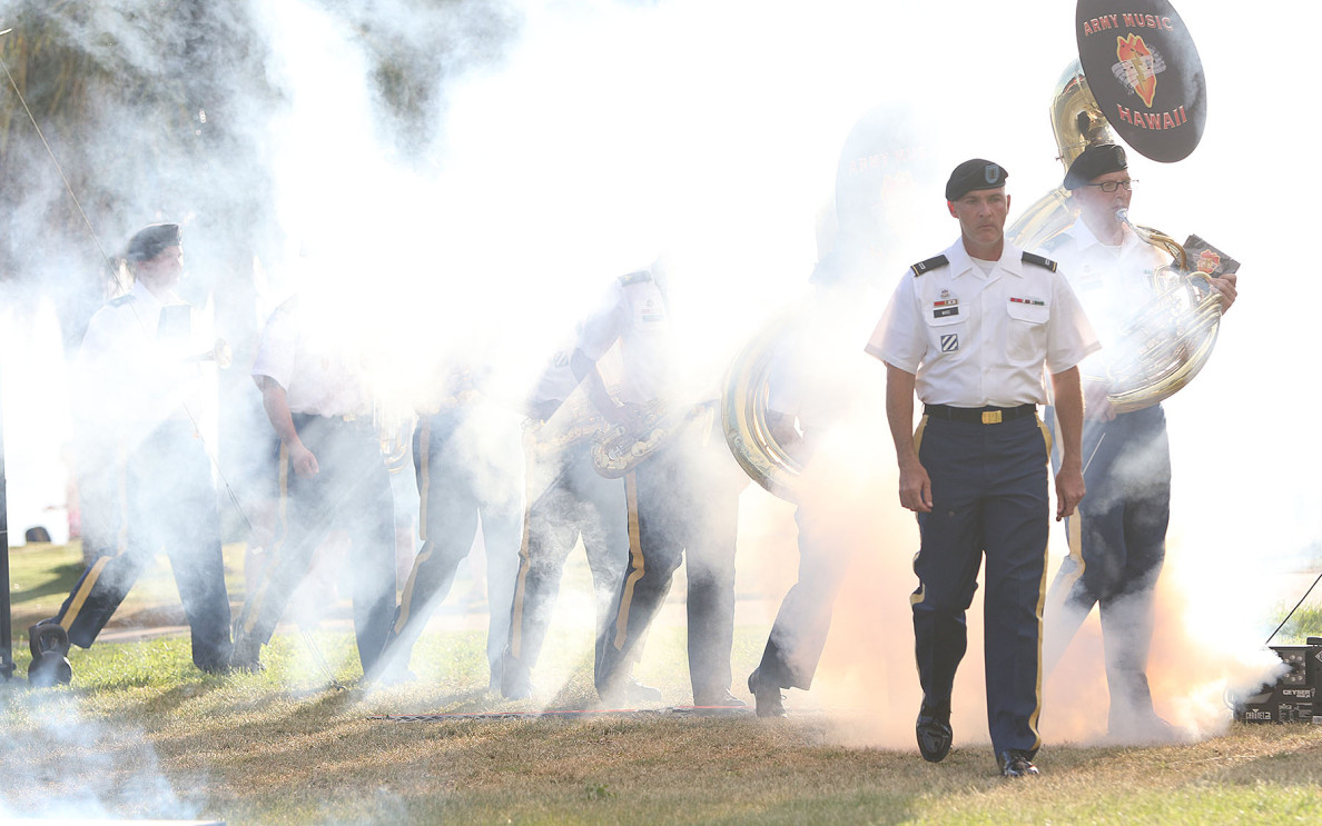 Members from the 25th Infantry Division Band march in the 2015 Legacy of Honor celebration held at Fort DeRussy on Tuesday. The program commemorates the U.S. Army's service to the Pacific region and this year celebrated the 240th year of the Army's service to the nation. The show included special effects like this smoke machine and a Jumbotron so spectators could watch live music performances and other presentations.