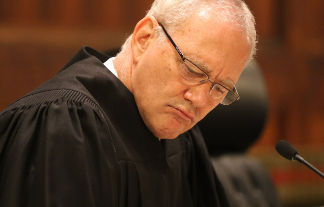 Hawaii State Supreme Court Associate Justice Michael Wilson listens to arguments in case involving Civil Beat's request to the HPD for records relating to disciplinary suspensions between 2003 and 2012. HPD is seeking an order requiring HPD to disclose the disciplanary suspension records 18 june 2015. photograph Cory Lum/Civil Beat