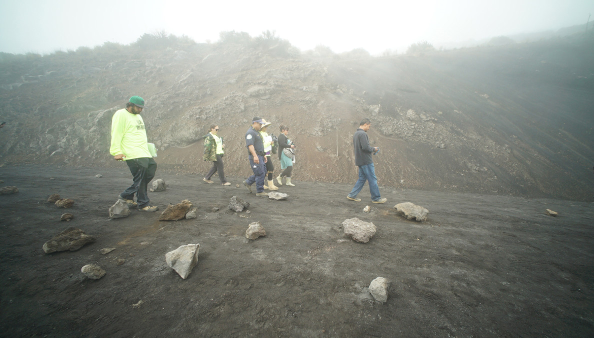 Kaluhiwa, right, of the DLNR finds scores of big rocks on the roadway. Ultimately, the DLNR decides to turn around law enforcement and TMT support vehicles and close the road.