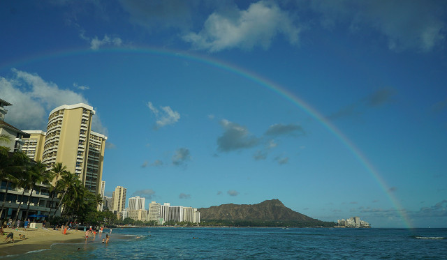Passing showers blanketed Waikiki's landmark Diamond Head with rainbow in foreground. 9 june 2015. photograph Cory Lum/Civil Beat