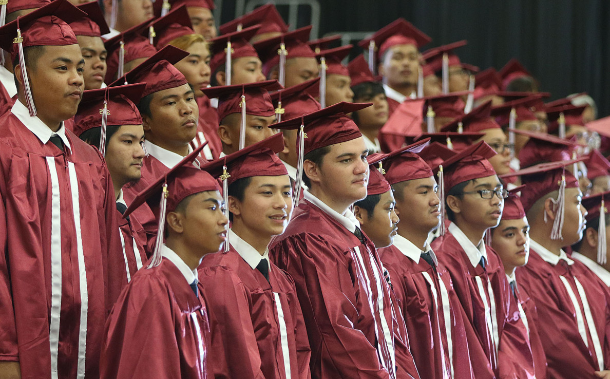 The Kalihi high school traditionally separates male and female graduates.