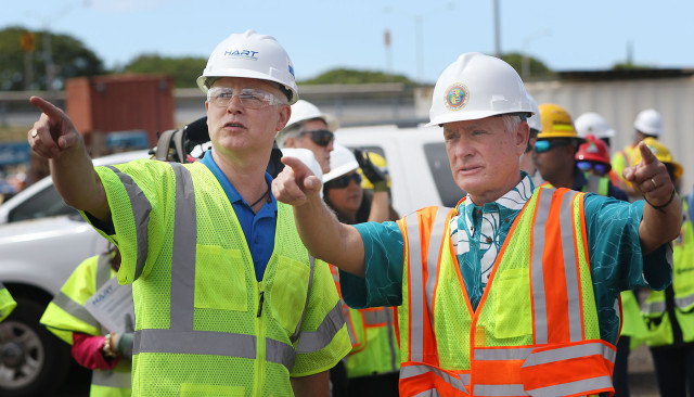 Executive Director and CEO of the Honolulu Authority for Rapid Transportation (HART) and Mayor Kirk Caldwell gesture after the press conference announcing 3 miles of completed guideway. 23 june 2015. photograph Cory Lum/Civil Beat