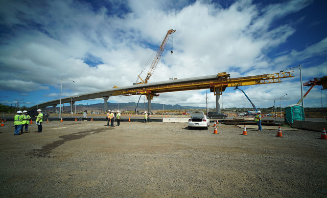 Workers stand around before press conference announcing 3 miles of completed guideway near the Fort Weaver and Farrington Highway intersection. 23 june 2015. photograph Cory Lum/Civil Beat