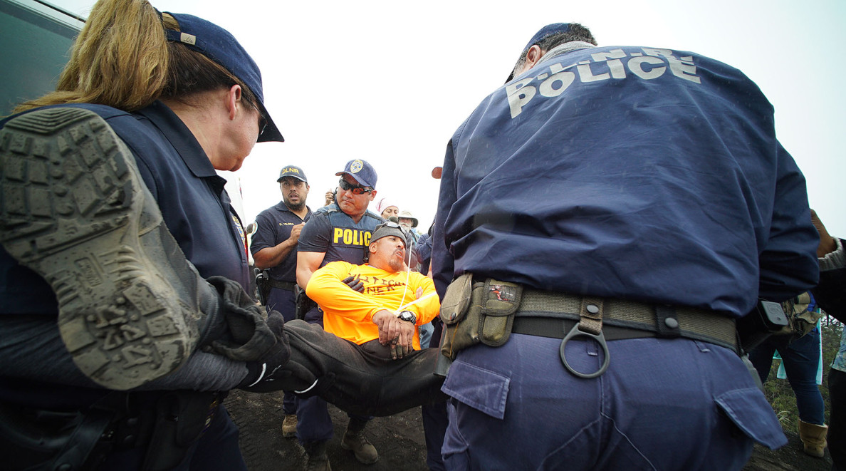 In all, 12 people are arrested Wednesday. Still, Gov. David Ige's call for 'a mutual respect and aloha' is generally heeded.