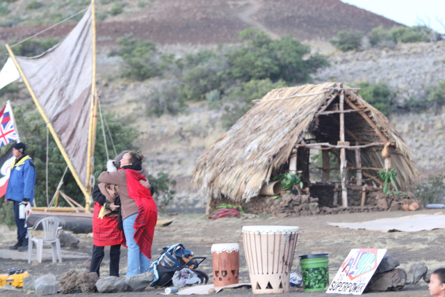 Thatched roofed structure and a small canoe across the street from the Maunakea visitors center. Maunakea. Hawaii. 24 june 2015. photograph Cory Lum/Civil Beat