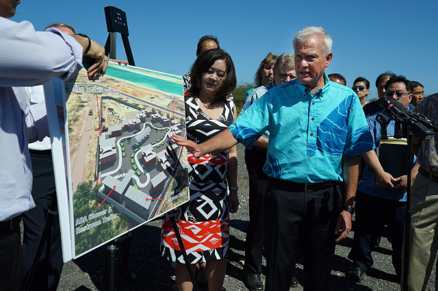 "Mayor Kirk Caldwell unveils his plan to build a ""modular"" facility for Honolulu's growing homeless population on vacant land at Sand Island."