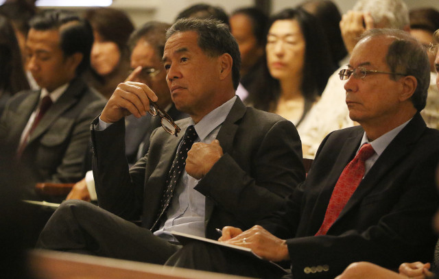 Hawaii State Supreme Court oral arguments. Clayton Hee listens to Attorney Eric Seitz representing the Sierra Club and Sen Clayton Hee petitioners vs. DR Horton-Schuler Homes, The Land Use commission, Office of Planning and Dept of Planning and Permitting .  25 june 2015. photograph Cory Lum/Civil Beat