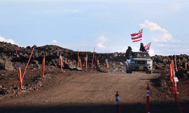 Truckload of Maunakea demonstrators near TMT access road atop the summit of Maunakea. 24 june 2015. photograph Cory Lum/Civil Beat