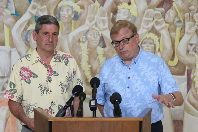 UH President David Lassner  and right, UH Hilo Chancellor Donald Straney field questions from media about TMT/Mauna Kea issues during press conference held at Bachman Hall fronting Jean Charlot fresco. 1 june 2015. photograph Cory Lum/Civil Beat