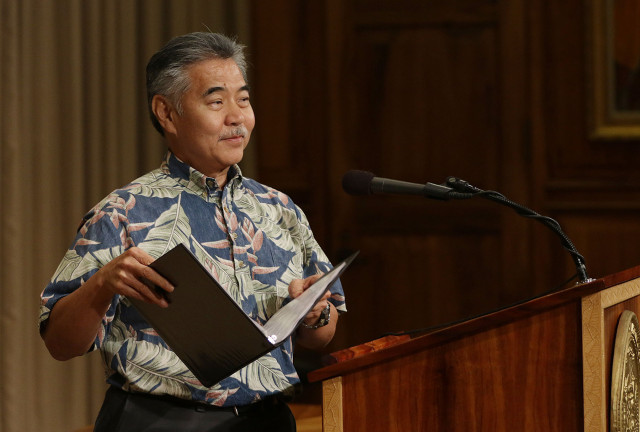 Governor David ige walks away from podium after answering media questions and announcing his short list of bills that he plans to veto. 29 june 2015. photograph by Cory Lum/Civil Beat