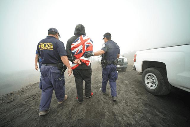 Protestor arrested on Mauna Kea, June 24, 2015.