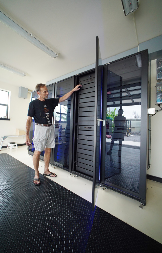 Blue Planet Research, Chief Technology Officer Vincent Paul Ponthieux opens racks containing Sony Lithium battery system at Pu'u Wa'awa'a Ranch laboratory. Hawaii Energy. 1 july 2015. photograph Cory Lum/Civil Beat