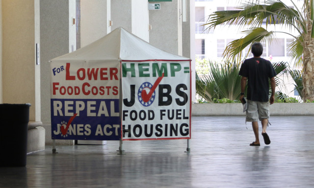 Hemp=Jobs. Small tent at entrance of the Marijuana Expo held at the Hawaii Convention Center. 19 july 2015. photograph Cory Lum/Civil Beat