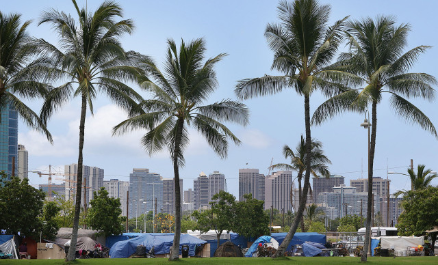 Tents along Ohe Street in Kakaako in a picturesque image juxtaposing Waikiki and the homeless encampment. 3 july 2015. photograph by Cory Lum/Civil Beat