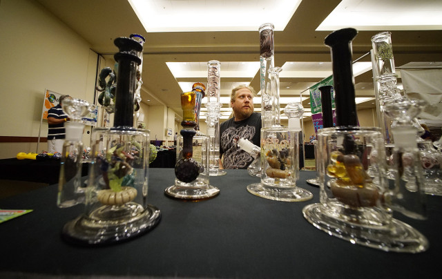Glass artist Mark Nowicki sits at his booth O.G. Tubes Hawaii featuring his hand made glass art at he Marijuana Expo. Hawaii Conventioin Center. 19 july 2015. photograph Cory Lum/Civil Beat