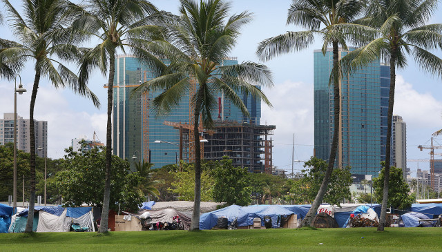 Homeless tents along Ohe Street in Kakaako fronting condominium skyline. 3 july 2015. photograph by Cory Lum/Civil Beat