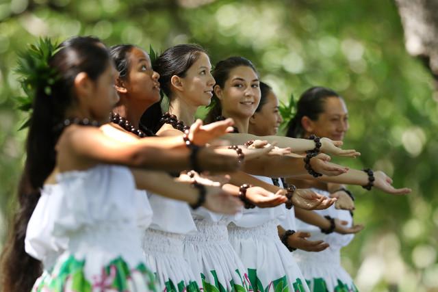 Women from Pua Alii Ilima, under direction of Kumu Jula Vicky Holt Takamine and Jeffrey Kanekaiwilani Takamine dance in the 38th Annual Prince Lot Hula Festival. 19 july 2015. photograph Cory Lum/Civil Beat