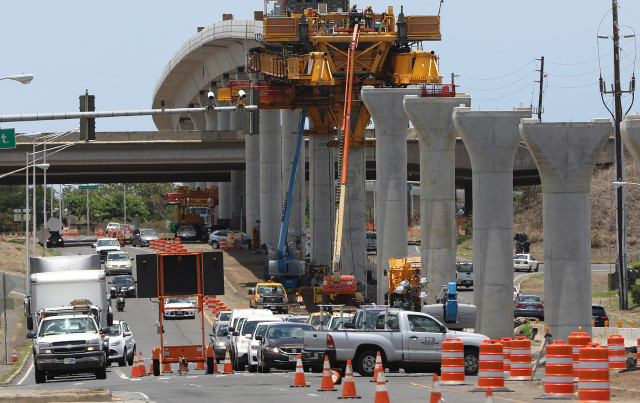 Rail guideway columns along Farrington Highway as construction moves eastward. 21 july 2015. photograph Cory Lum/Civil Beat