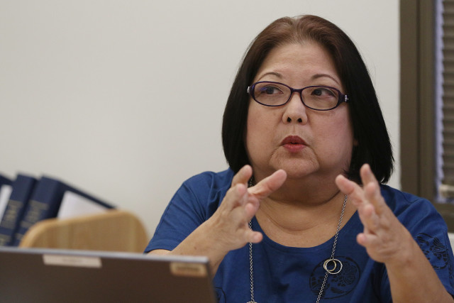 Hawaii State Ethics Commission Chair Susan DeGuzman gestures during meeting.  22 july 2015. photograph Cory Lum/Civil Beat