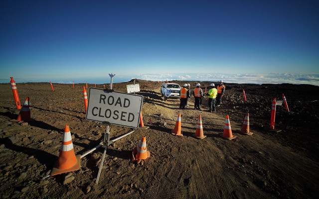 Private security officers stand near 'Road Closed' sign near TMT constructon area near the summit of Mauna Kea. Hawaii  24 june 2015. photograph Cory Lum/Civil Beat