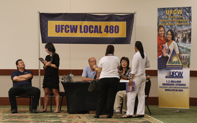 UFCW Local 480 union display at the Marijuana Expo held at the Hawaii Convention Center. 19 july 2015. photograph Cory Lum/Civil Beat