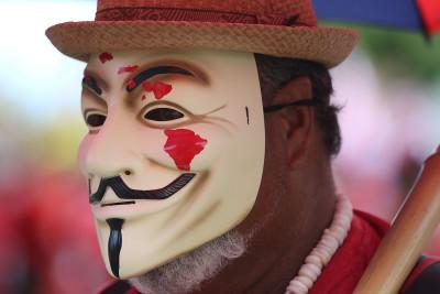 Masked Aloha Aina Unity March demonstrator. 9 aug 2015. 9 aug 2015.  photograph by Cory Lum/Civil Beat