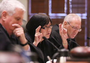 Hawaii State Supreme Court Associate Justice Sabrina McKenna questions attorney's during oral arguments. 27 aug 2015.  photograph by Cory Lum/Civil Beat