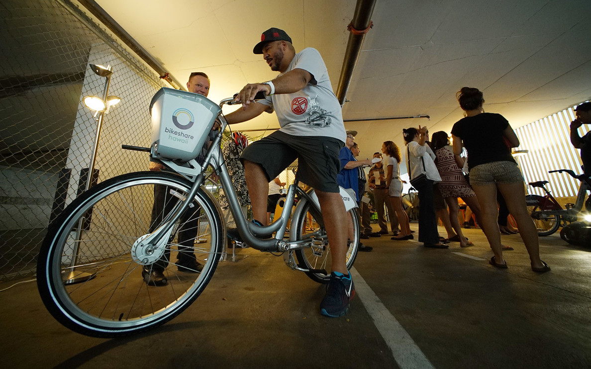Shawn 'Doc' Boyd checks out one of the Bikeshare options. With the help of public input, a final decision will be made in the coming months for the program, which already has $1 million commitments from the state and the city, but is seeking more funds.