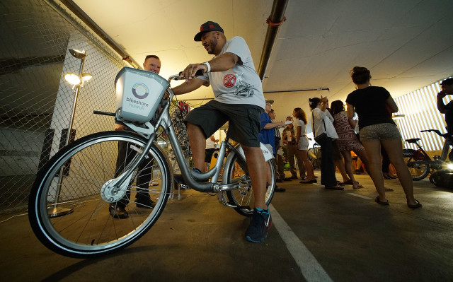 Shawn 'Doc' Boyd checks out one of the Bikeshare bike options. Bikeshare Hawaii had four bike system choices installed that with input from the public, will choose from in the coming months.  23 aug 2015. photograph Cory Lum/Civil Beat