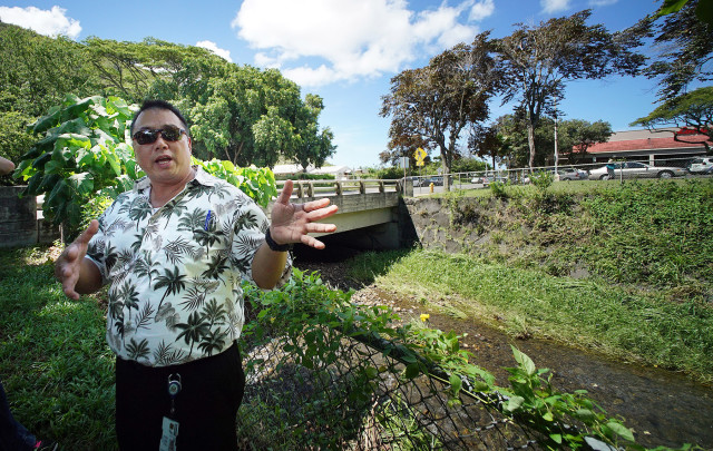 Derek Chow, Chief with the US Army Corps of Engineers, Honolulu District stands fronting the Manoa Stream Bridge near the Manoa Safeway.  28 aug 2015. photograph Cory Lum/Civil Beat