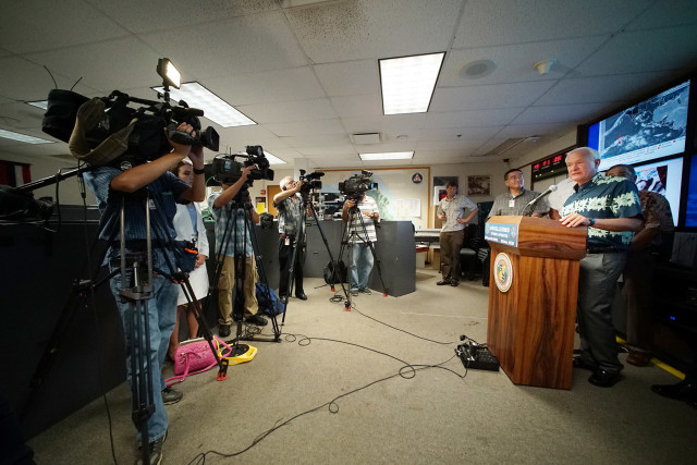 Mayor Kirk Caldwell speaks at press conference advising current tracking of tropical storm Guillermo at the EOC, Fasi Municipal Building Basement. 4 aug 2015. photograph Cory Lum/Civil Beat