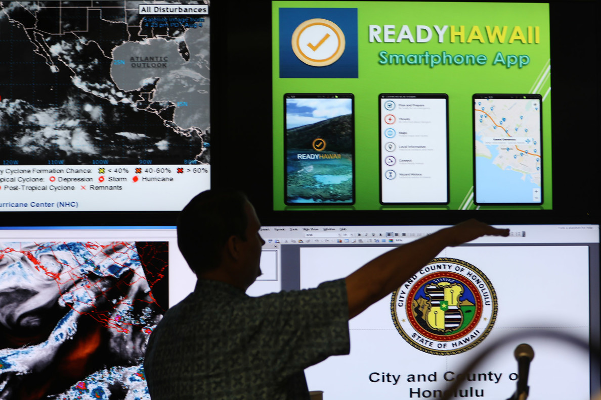 Screens display storm preparation information at the city's Emergency Operations Center during a news media briefing Tuesday. Later in the week, new concerns were raised about Tropical Storm Hilda, which also seems to be blowing our way.