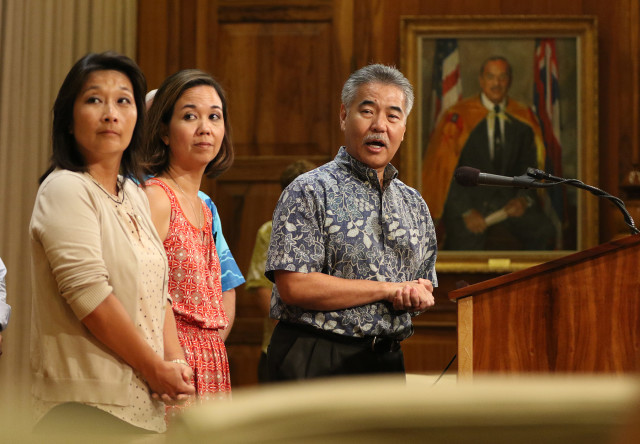 Governor David Ige with Sen. Jill Tokuda right and left, Sylvia Luke during press conference on homeless. 17 aug 2015. photograph Cory Lum/Civil Beat