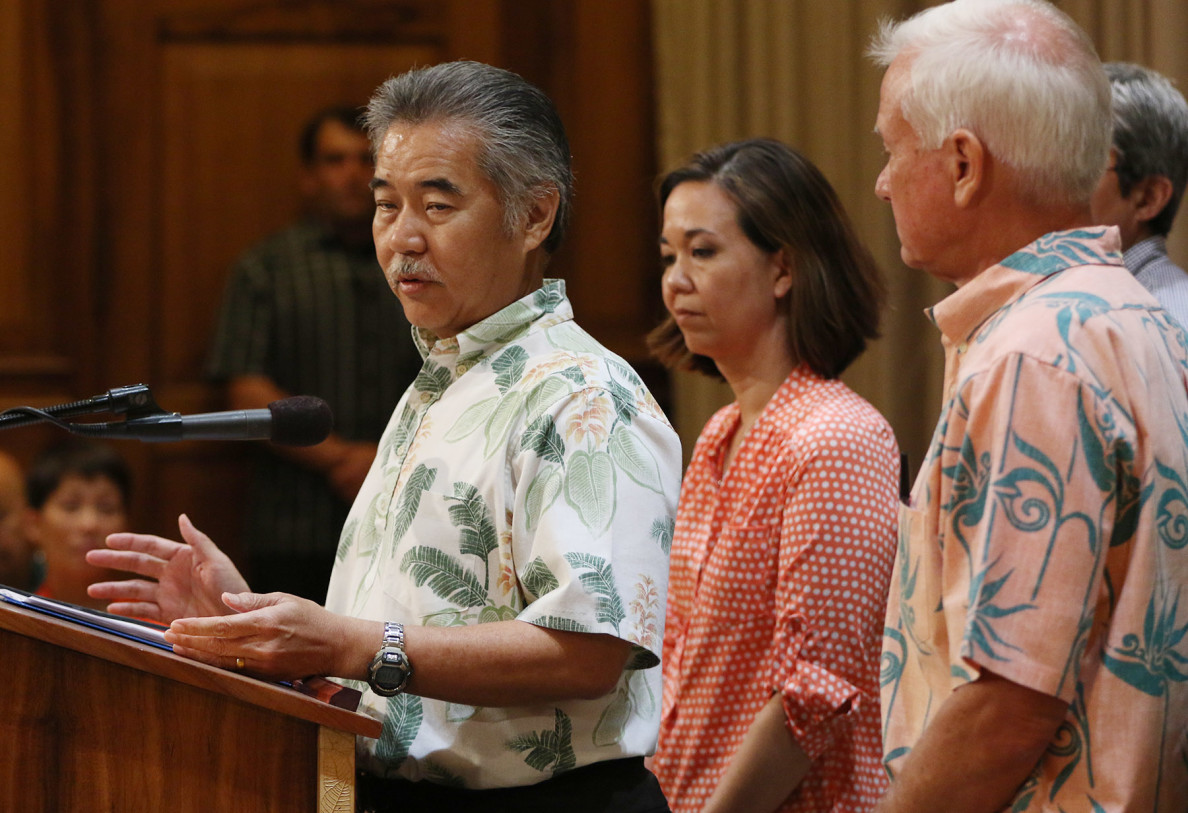 Left, Gov David Ige and right, Mayor Kirk Caldwell, as Senator Jill Tokuda at press conference discussing Governor's leadership team on homelessness. 3 aug 2015. photograph Cory Lum/Civil Beat