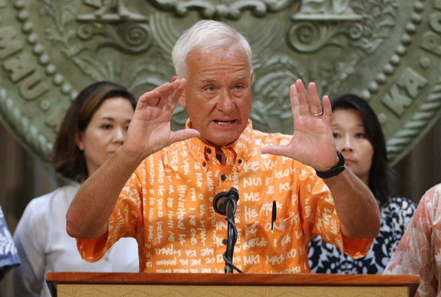 Mayor Kirk Caldwell gestures during press conference at Governor Ige's office on homeless. 27 aug 2015. photograph Cory Lum/Civil Beat