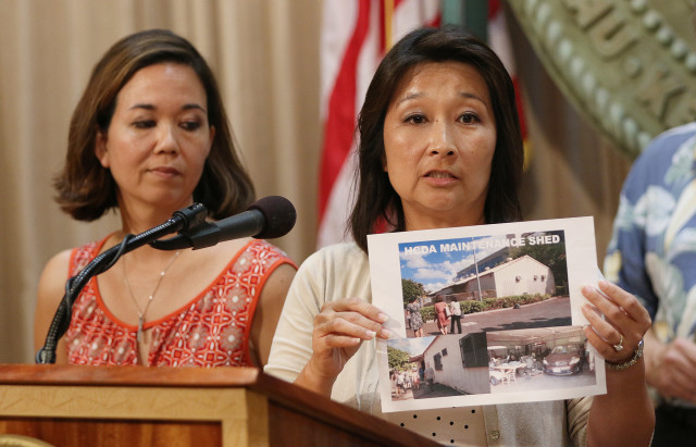 Rep. Sylvia Luke holds HCDA maintenance shed photograph with left, Sen Jill Tokuda during press conference on homeless at the Governor's office. 17 aug 2015. photograph Cory Lum/Civil Beat