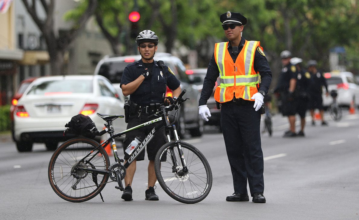 Honolulu Police Department officers on traffic duty before the Aloha Aina Unity March on Kalakaua Avenue. 9 aug 2015. photograph by Cory Lum/Civil Beat