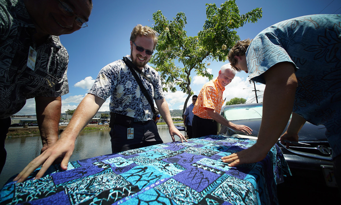 Caldwell is assisted by spokesmen Adam LeFebvre, left, and Jesse Broder Van Dyke, right, as they spread out a tablecloth prior to the media event. The mayor also announced he was vetoing a bill to expand areas where people are prohibited from sitting or lying in public, saying that widening the ban may make it vulnerable to a legal challenge.