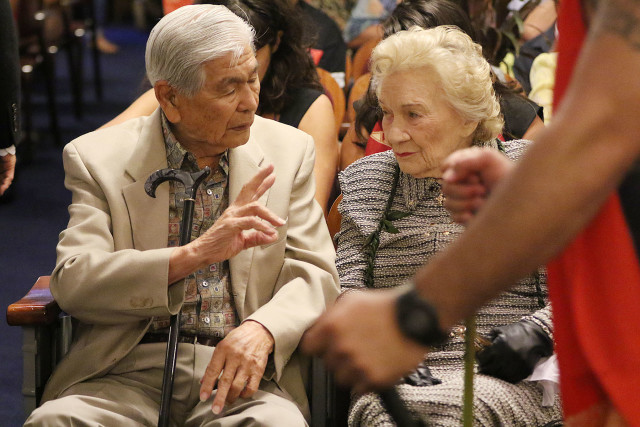 Left, Governor George Ariyoshi speaks to right, Princess Abigail Kawananakoa before oral arguments on Mauna Kea at Aliiolani Hale / Hawaii State Supreme Court Building. 27 aug 2015. photograph by Cory Lum/Civil Beat