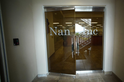 Doors  leading into second floor offices of Nan Inc. 11 aug 2015. photograph Cory Lum/CIvil Beat