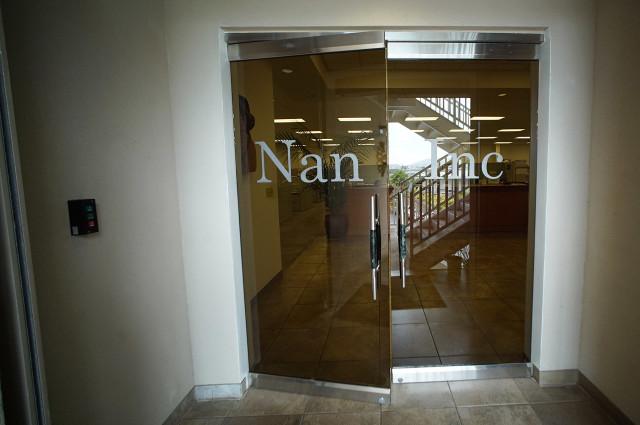 Doors leading into second floor offices of Nan Inc. 11 aug 2015. photograph Cory Lum/CIvil Beat