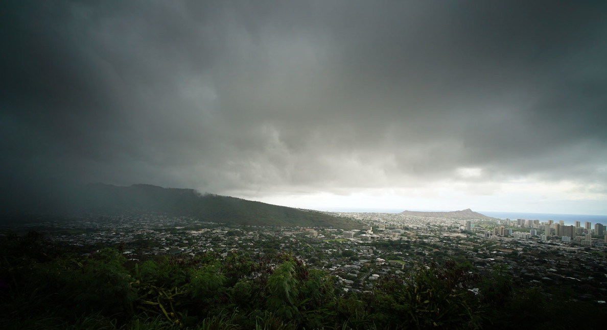 Rainclouds gathered over Honolulu on Wednesday. More heavy precipitation is forecast for the next several days, and Ignacio, which had hurricane status Thursday afternoon, could impact the islands next week.