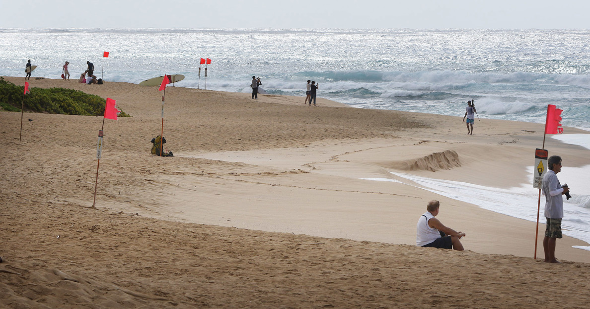 Orange high-surf warning signs dot the shoreline at Sandy Beach on Thursday, and most visitors stayed out of the water.