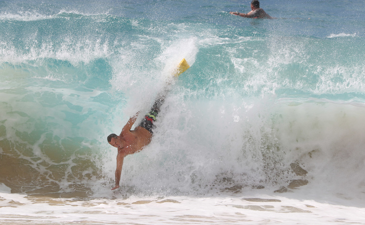 A bodysurfer goes airborne courtesy of Guillermo's large surf at Sandy Beach on Thursday.
