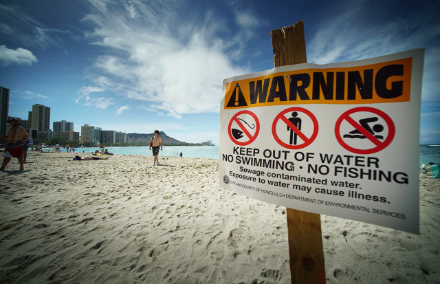 Beach Closed sign fronting the Sheraton Waikiki after 500,000 gallons of sewage poured into the Ala Moana area after tropical storm 'Kilo' rolled thru. 25 aug 2015. photograph Cory Lum/CIvil Beat