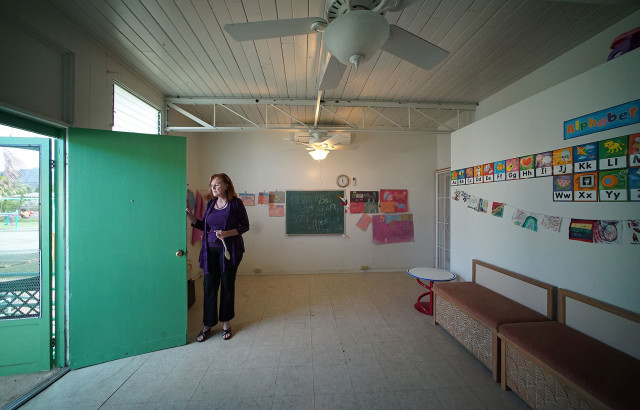 Weinberg Village Waimanalo Director Holly Holowach stands inside a unit. The homes are remodeled portable buildings from Kapiolani Community College. 27 aug 2015. photograph Cory Lum/Civil Beat
