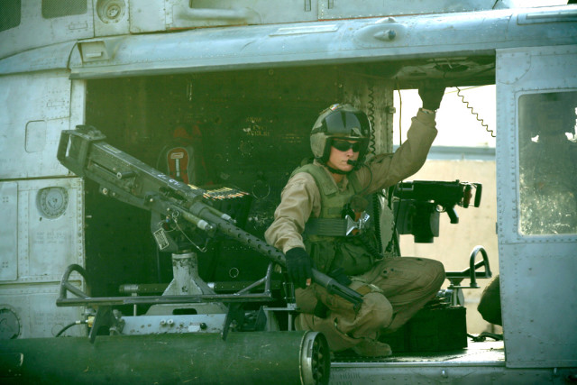 Cpl. Lisa M. Bodenburg, a UH-1N crew chief with Marine Light Attack Helicopter Squadron 367, 3rd Marine Aircraft Wing, prepares before taking off on an aerial reconnaissance mission.