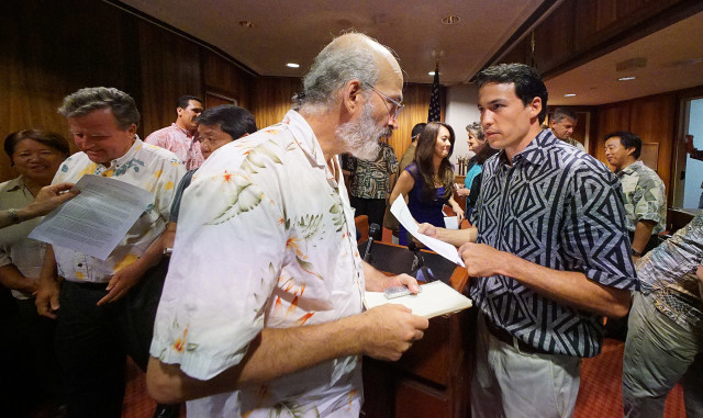 Blogger Henry Curtis guestions Rep Chris Lee after public officials from all islands made statements on the future of electric utilities in Hawaii at press conference held at the Capitol. 3 sept 2015. photograph Cory Lum/Civil Beat