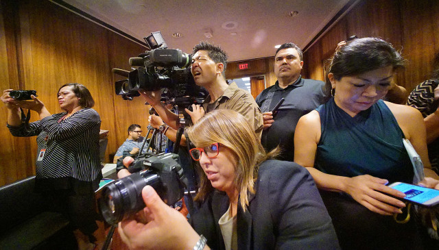 Photographers cover public officials from all islands making statements on the future of electric utilities in Hawaii. 3 sept 2015. photograph Cory Lum/Civil Beat